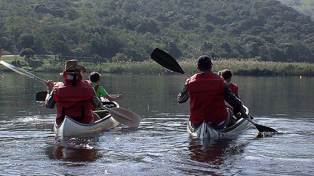 Two men and two boys canoeing