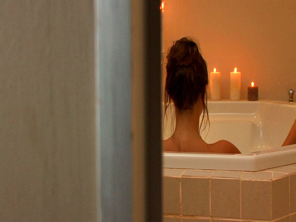 Dark haired woman relaxing in a white bath - 1114-1722