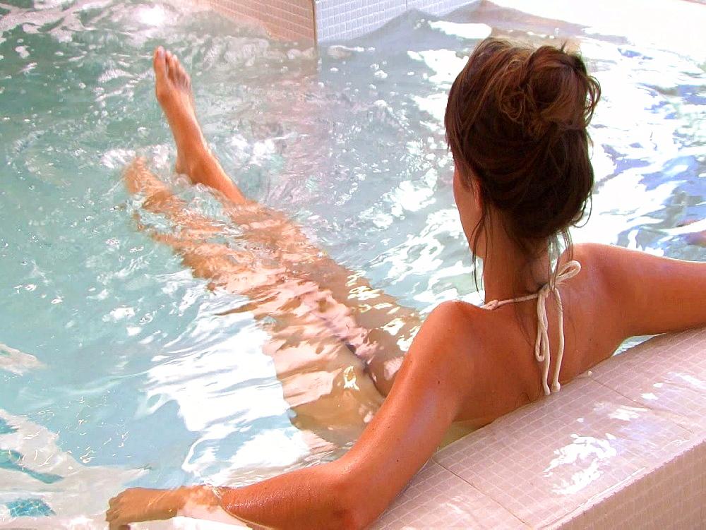 Woman splashing about in water