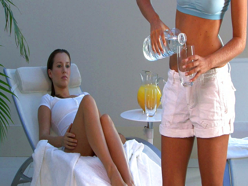 Woman pouring water whilst a brunette relaxes - 1114-1738
