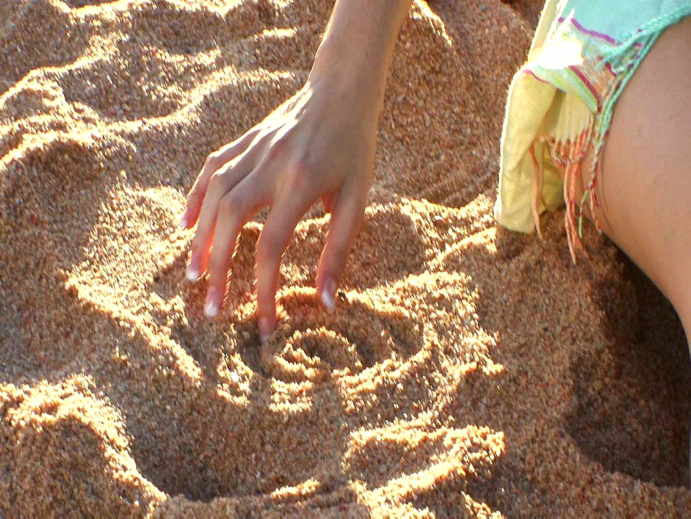 Fingers playing in sand