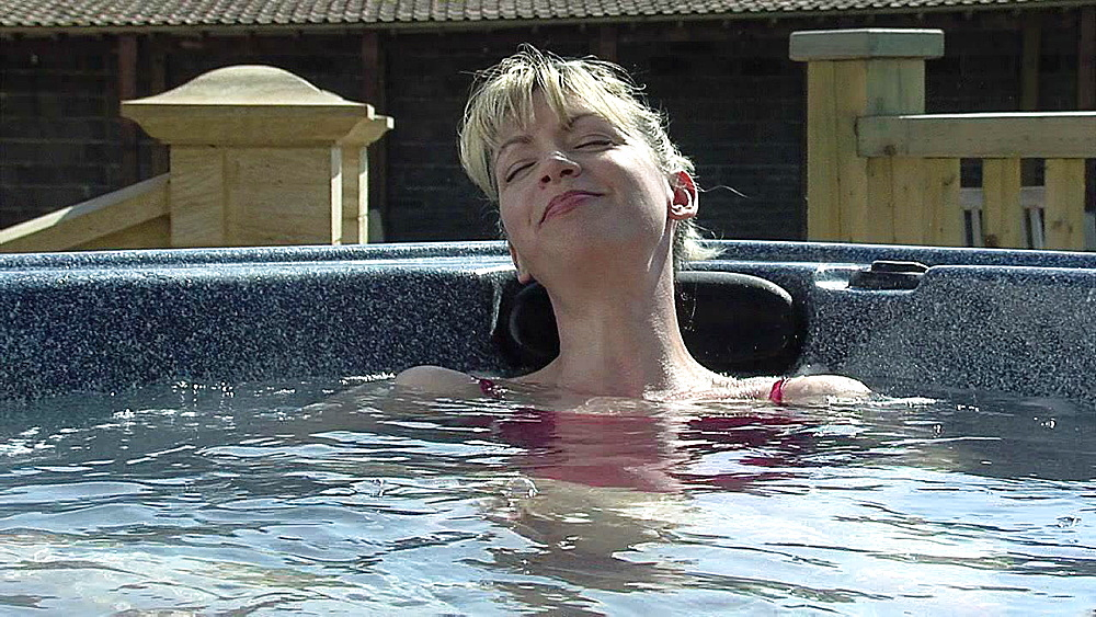Woman relaxing in a bath of hot water