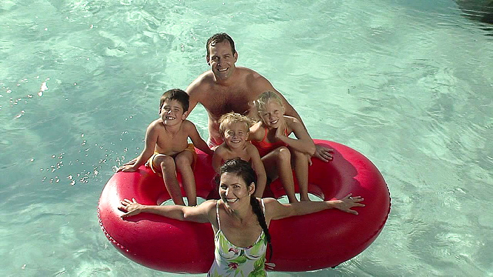 Two adults and three children in a rubber ring