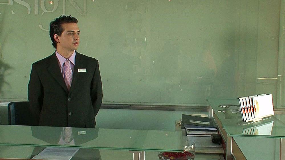 Concierge waits behind reception - 1114-2119