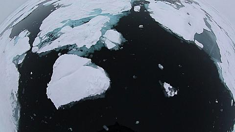 Extreme wide angle view (POV) of ice breaker breaking through ice, Antarctica