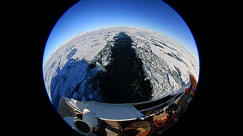 Extreme wide angle view (porthole style) of ice breaker trail at stern, Antarctica - 1159-1301