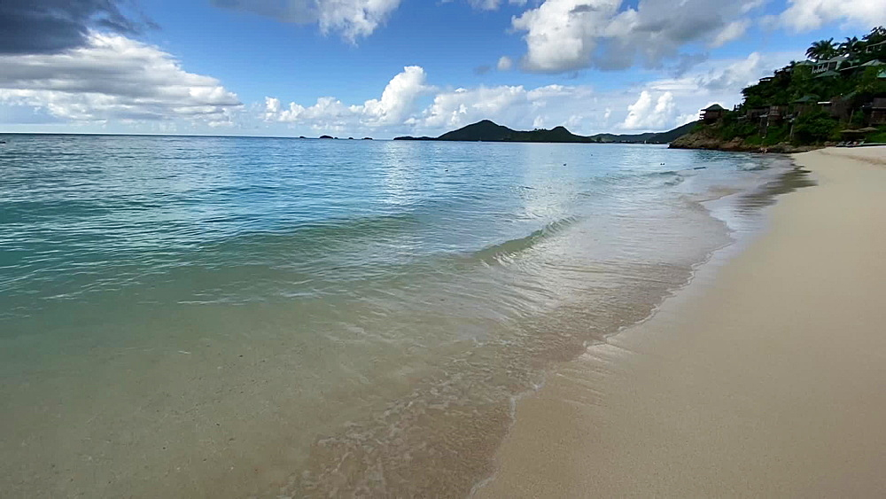 Valley Church Beach, turquoise waves roll into shore, approaching rain shower, Antigua, Leeward Islands, West Indies, Caribbean, Central America