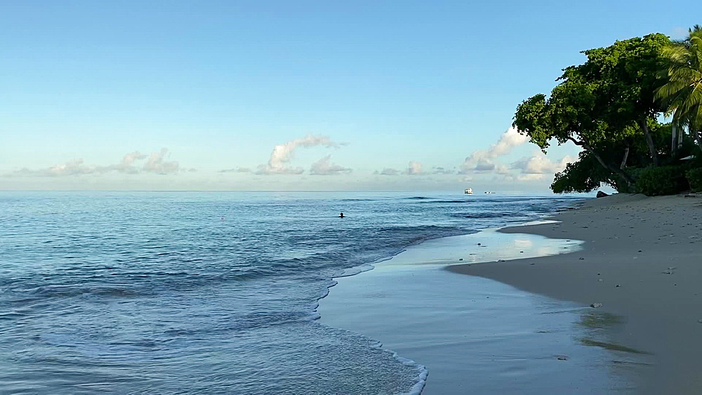 Calm waters lapping on the fine sand of Paynes Bay Beach at dawn, West Coast, Barbados, West Indies, Caribbean, Central America