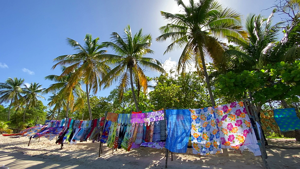 Colourful beach stall and palm trees, Saltwhistle Bay Beach, Mayreau, Grenadines, West Indies, Caribbean, Central America