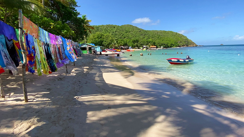 Colourful beach stall, shadow of palm trees, white sand, small boats, Saltwhistle Bay Beach, Mayreau, Grenadines, West Indies, Caribbean, Central America