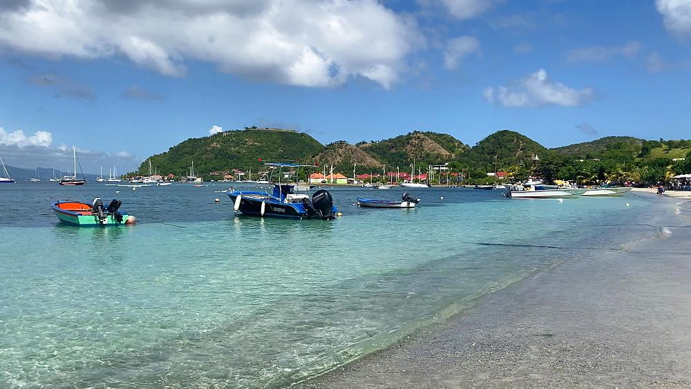 Tropical Les Saintes bay, beach, calm water, small boats, Terre de Haut island, Iles des Saintes, Guadeloupe, West Indies, Caribbean, Central America