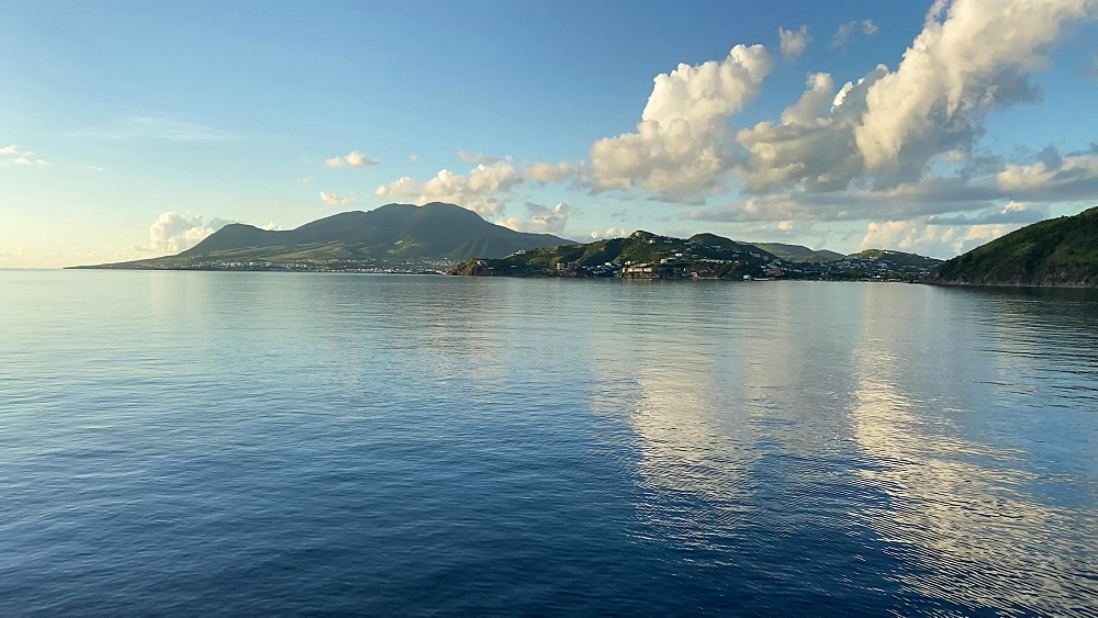 Southern St. Kitts from the sea, calm sea in evening sun, off South Friars Bay and Frigate Bay, St. Kitts, West Indies, Caribbean, Central America