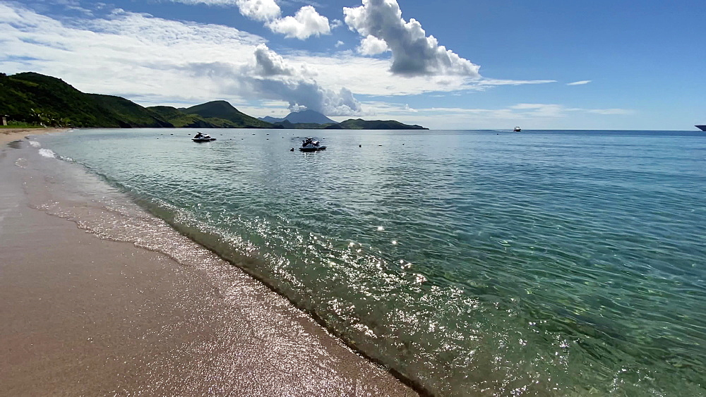 Aquamarine shallow calm sea, lapping waves, dappled light, jet skis, South Friars Bay, St. Kitts, West Indies, Caribbean, Central America