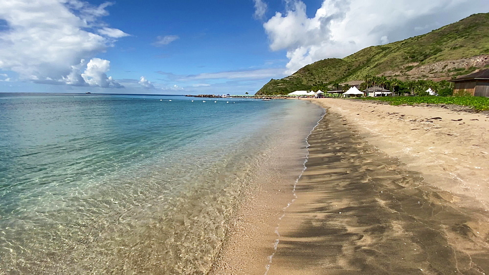 Aquamarine shallow calm sea, lapping waves, beach club, South Friars Bay, St. Kitts, West Indies, Caribbean, Central America