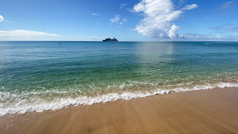 Cruise ship anchored in aquamarine calm sea, lapping waves on the beach, Carambola Beach, South Friars Bay, St. Kitts, West Indies, Caribbean, Central America