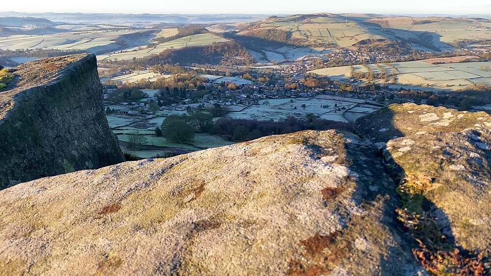 View of Curbar village, frosty Derwent Valley from Curbar Edge, low winter sun, Peak District National Park, Derbyshire, England, United Kingdom, Europe