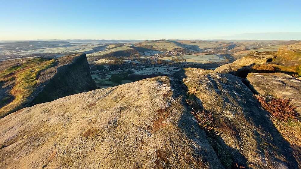 Lichen covered rocks of Curbar Edge, frosty Derwent Valley beyond, Derbyshire Peak District National Park, England - 1167-2361