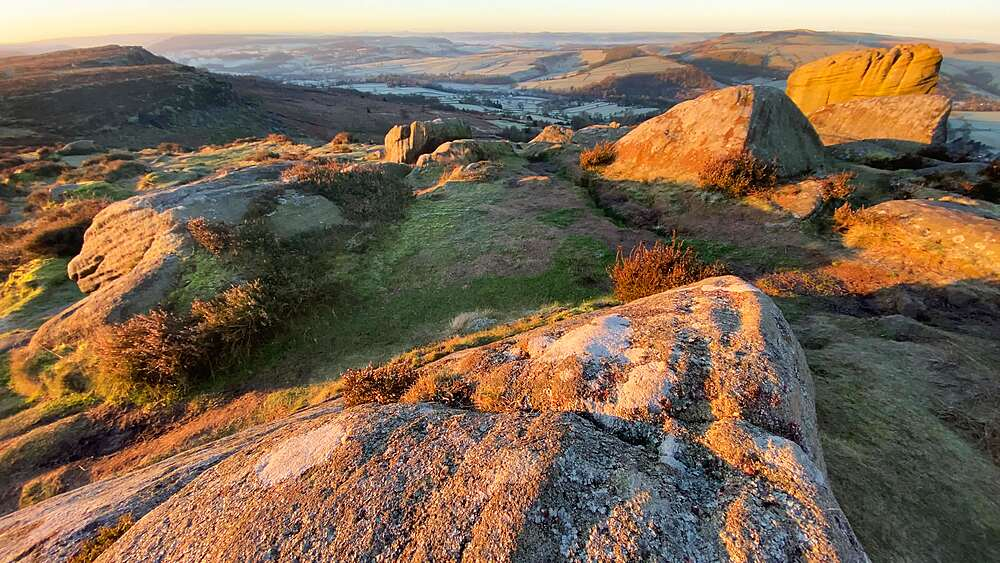 Lichen covered rocks of Curbar Edge at sunrise in winter, Peak District National Park, Derbyshire, England, United Kingdom, Europe