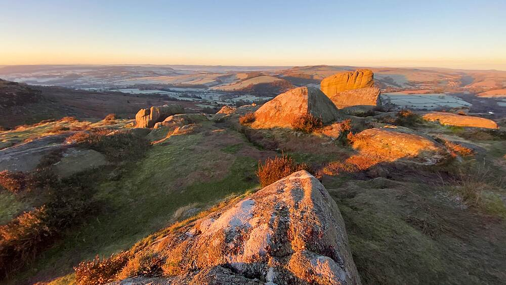 View across Curbar Edge and moor at sunrise, frosty Derwent Valle in winter, Peak District National Park, Derbyshire, England, United Kingdom, Europe