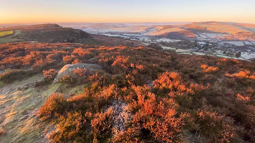View across Curbar Edge and moor at sunrise, frosty Derwent Valley in winter, Peak District National Park, Derbyshire, England, United Kingdom, Europe