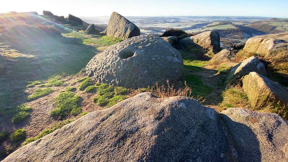 Millstone on Curbar Edge, heather in low winter sun, Peak District National Park, Derbyshire, England, United Kingdom, Europe