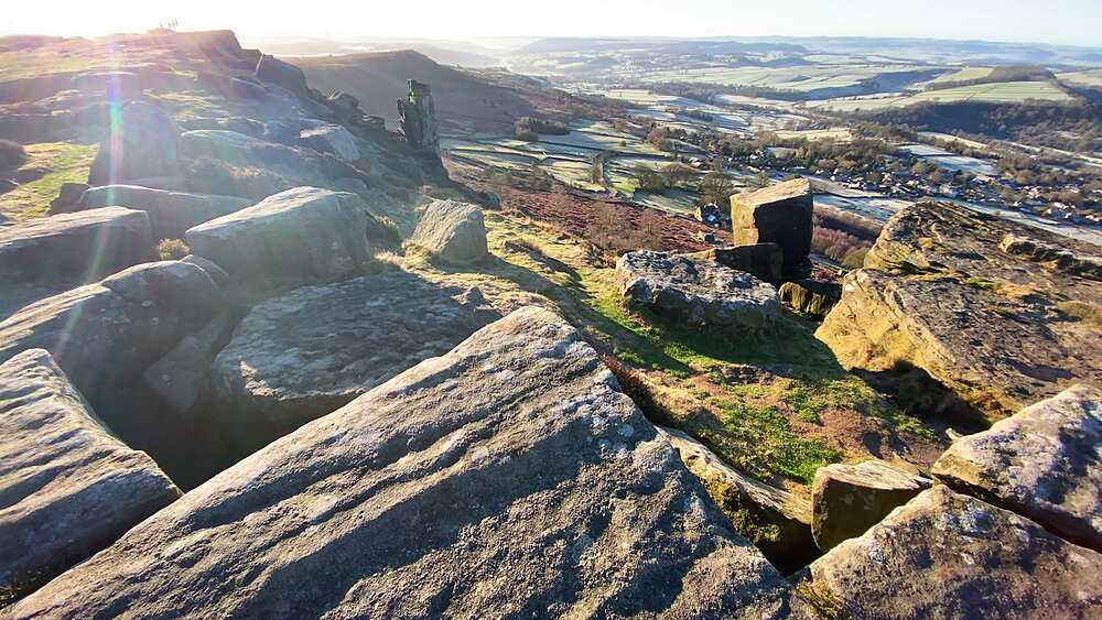 Curbar Edge, frosty Derwent Valley, low winter sun, silhouetted people, Peak District National Park, Derbyshire, England, United Kingdom, Europe