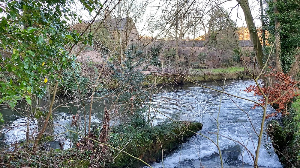 Diverted River Wye at Caudwells Mill, Grade II listed water power mill, in winter, Rowsley, Peak District, Derbyshire, England, United Kingdom, Europe