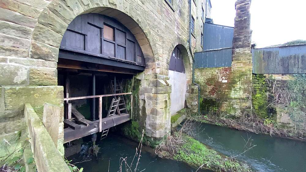 Working machinery, Caudwells Mill, Grade II listed historic water power mill, in winter, Rowsley, Peak District, Derbyshire, England, United Kingdom, Europe