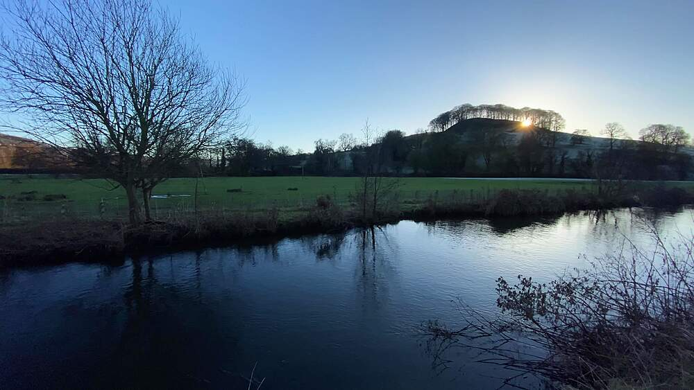 Peak Tor hill at sunset in winter, River Wye, Rowsley, Peak District National Park, Derbyshire, England, United Kingdom, Europe