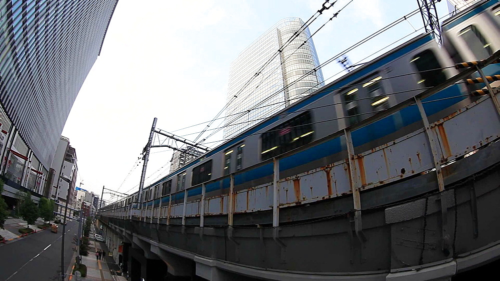 Trains passing by on elevated rail track in Akihabara, Tokyo, Japan - 1172-1137