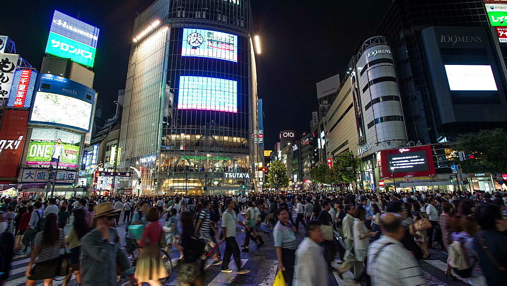 Time lapse pan-up footage of pedestrians and vehicles at Shibuya scramble crossing at night, Tokyo, Japan - 1172-1334