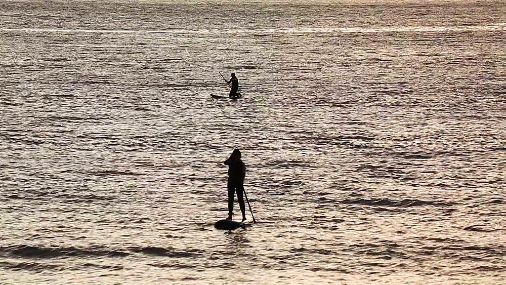 Paddle surfers at sunset in Enoshima, Kanagawa Prefecture, Japan - 1172-1448