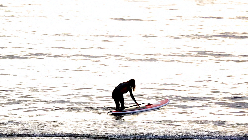 Paddle surfer at sunset in Enoshima, Kanagawa Prefecture, Japan - 1172-1452
