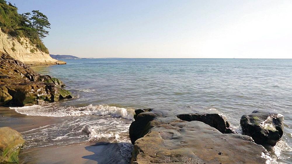 Waves crashing against rocky shore in Inamuragasaki, Kanagawa Prefecture, Japan - 1172-1474