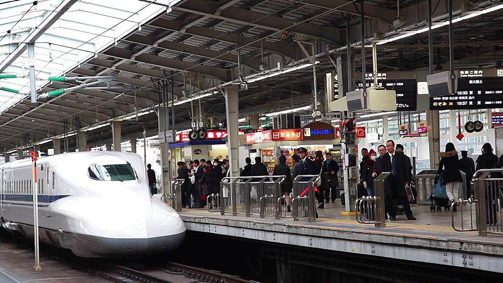 Osaka, JP - January 24, 2015:  N700 Series Shinkansen bullet train arriving at Shin-Osaka station. - 1172-1558
