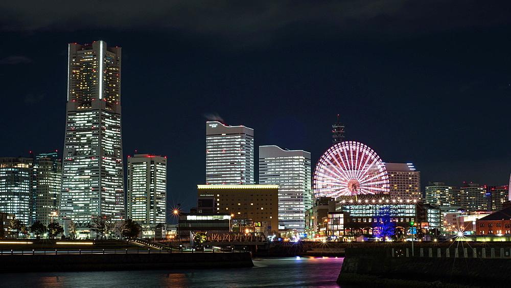 Yokohama, JP - February 13, 2015:  Time-lapse view of Minatomirai cityscape at night in Yokohama, Japan - 1172-1651