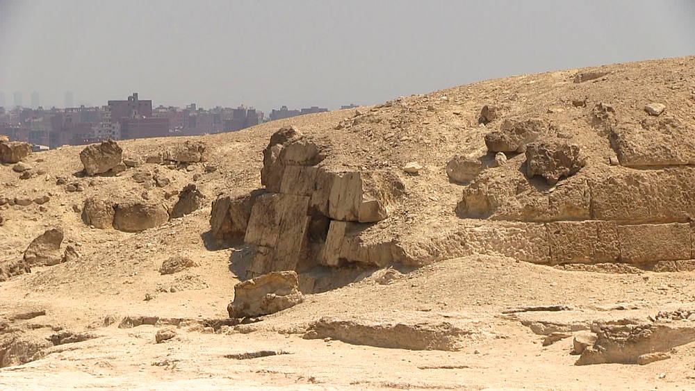 Pan from Giza plateau at the edge of the Sahara Desert, sand dune to Cairo city skyline, Egypt, Africa