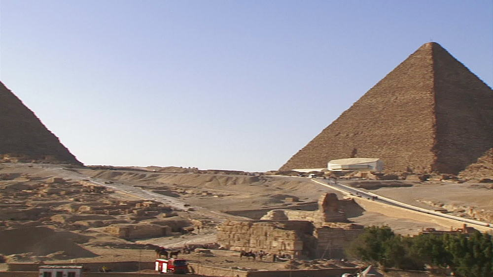 Pan from the Pyramid of Khafre to the Pyramid of Khufu, The Great Pyramid of Giza on the northern edge of the Giza Plateau, Egypt, Africa - 1182-107