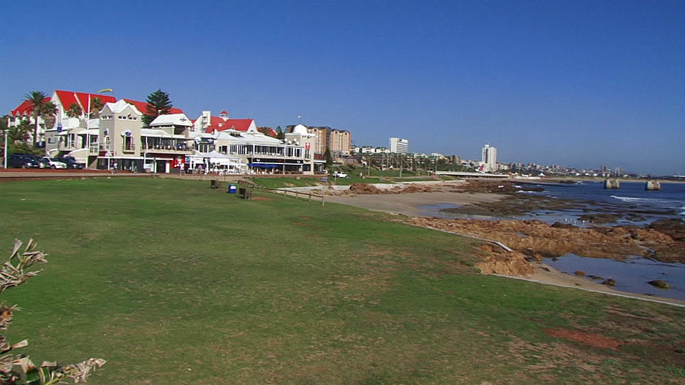 Pan from buildings/ shops/houses to the sea, East London beachfront, South Africa - 1182-141