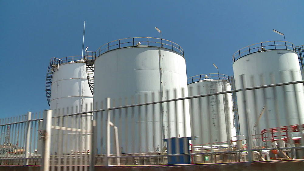 Tracking shot of container tanks at an Oil Refinery in Cape Town, South Africa - 1182-170