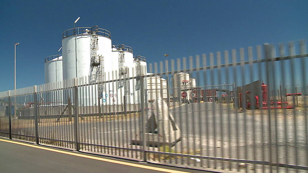 Tracking shot of container tanks at an Oil Refinery in Cape Town, South Africa - 1182-171