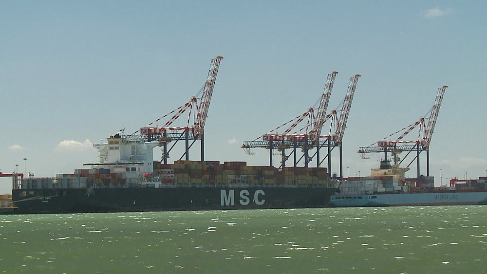 MSC and Maersk Line container vessels docked in harbour at Cape Town Harbour. Harbour cranes, choppy seas, windy seas, South Africa - 1182-178