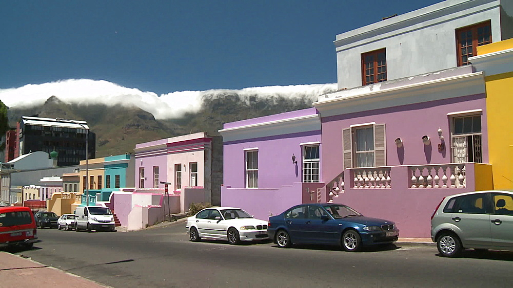 A row of Colourful houses with Clouds coming over Table Mountain in the background, Cape Town, South Africa - 1182-181
