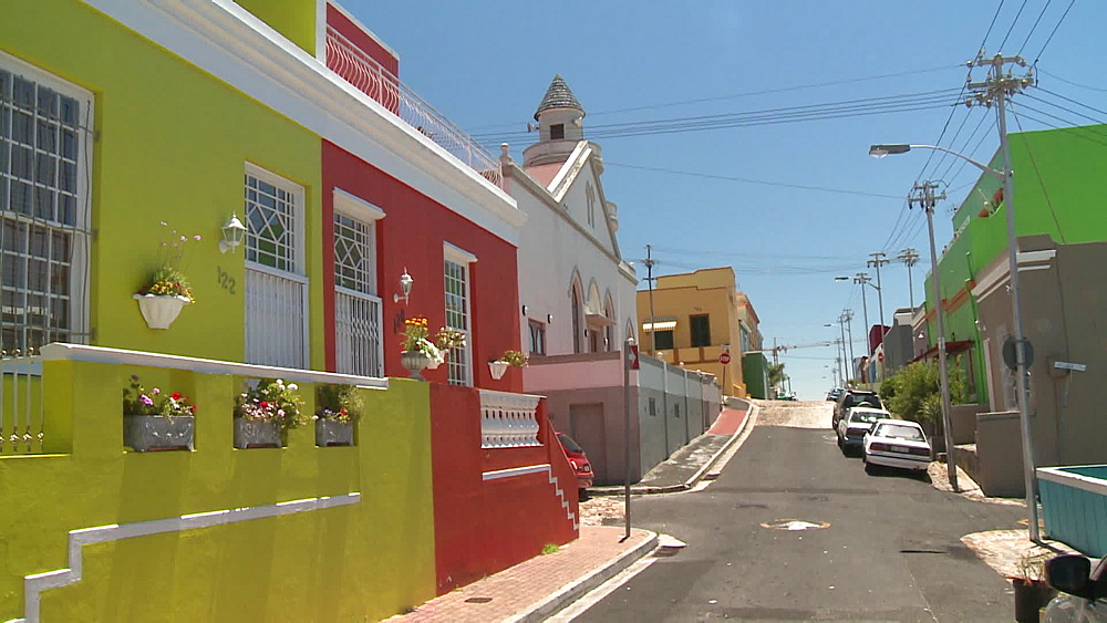 A row of Colourful houses next to a church in a suburb, South Africa - 1182-184