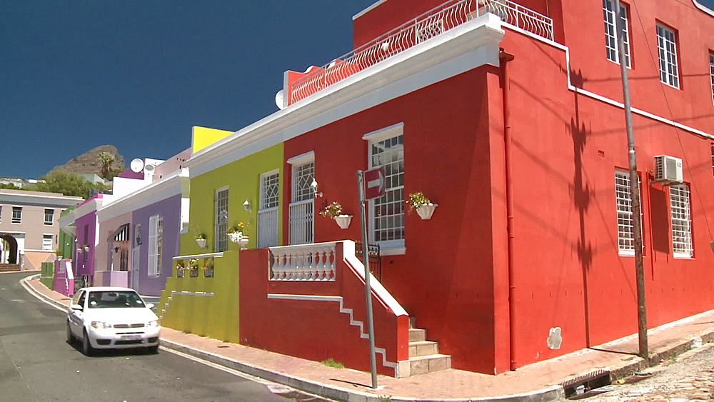 A row of Colourful houses with a car coming down the street, Cape Town, South Africa - 1182-185