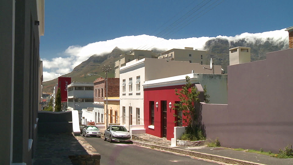 A row of Colourful houses with Clouds coming over Table Mountain in the background, Cape Town, South Africa  - 1182-186