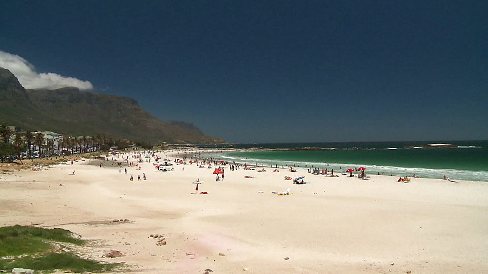 People on the beach, people on Clifton Beach, Camps Bay, Table Mountain in the background. Cape Town, South Africa - 1182-201