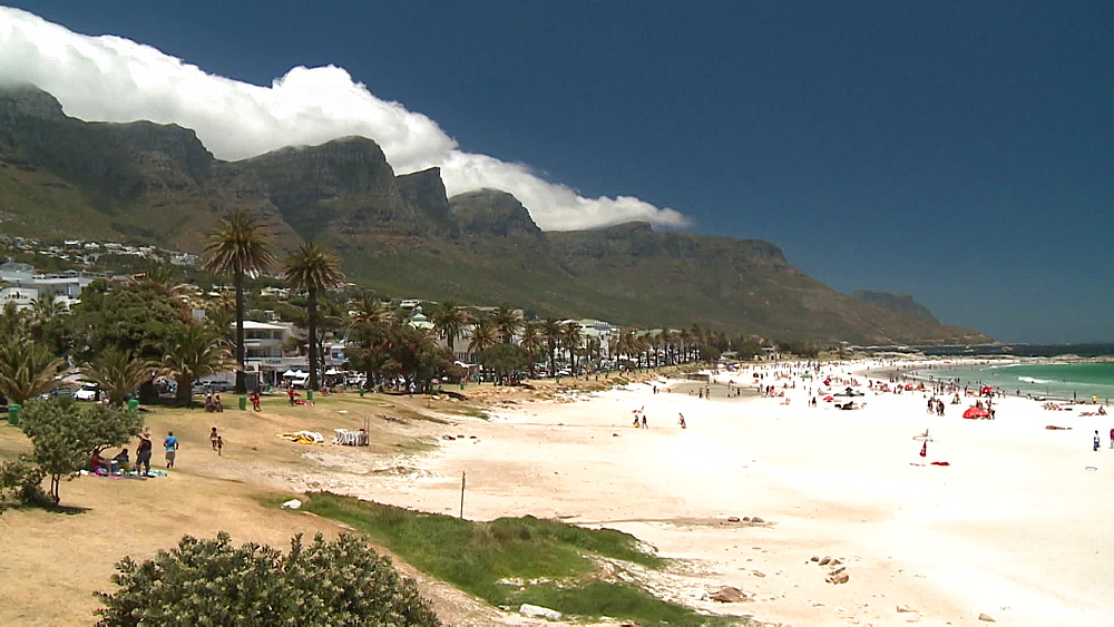 Pan from Table Mountain with clouds rolling over to people on the beach, people on Clifton Beach, Camps Bay, Cape Town, South Africa - 1182-202