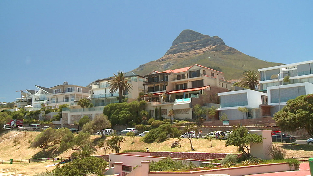 Signal Hill with large houses, a road and traffic in the foreground, Cape Town South Africa - 1182-205