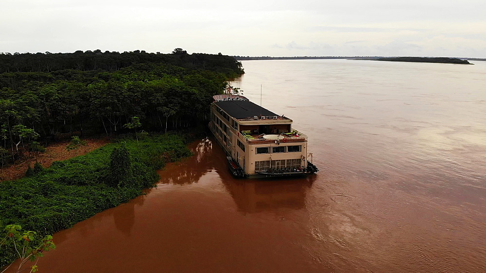 Aerial shot of the luxury riverboat and the Amazon Forest and River, Amazon, Peru, South America